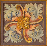 Cordoba - The baroque carved and polychrome floral decoration in church Iglesia de San Augustin. Stock Photos