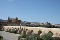Cordoba bridge over Guadalquivir river royalty free stock photos