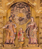 Cordoba - The carved Holy Family sculptural group on the main altar in church of Monastery of st. Ann and st.Joseph Stock Images