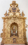 Cordoba - The carved polychrome altar of Madonna from 17. cent. in church of monastery Convento Santa Marta. Stock Photo