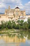 Cordoba Cathedral and Guadalquivir River. Mezquita Cathedral (The Great Mosque) by the Guadalquivir river in Cordoba, Spain, Andalusia region stock photos