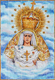 Cordoba - The ceramic tiled, cried Madonna on the facade of church Iglesia de Nuestra Senora de Gracia Stock Photos