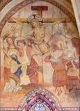 Cordoba - das mittelalterliche Fresko der Kreuzigung in der Hauptapsis von Kirche Iglesia De San Lorenzo Stockbild