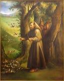 Cordoba - den moderna målarfärgen av St Francis av Assisi som predikar till fåglarna från 20 cent i kyrkliga Convento de Capuchin Arkivbild
