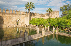 Cordoba - The gardens of Alcazar de los Reyes Cristianos castle in evening. Light Royalty Free Stock Images