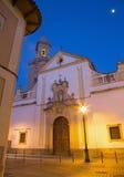 Cordoba - kyrkliga Iglesia de San Andres på skymning med den sena barocka portalen Arkivbilder
