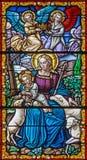 Cordoba - Madonna med barnet bland shepsna på fönsterrutan i kyrkliga Convento de Capuchinos Royaltyfria Bilder
