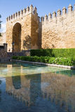 Cordoba - The medieval walls of the town in evening light and The Puerta del Almodovar Royalty Free Stock Photography