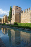 Cordoba - medieval walls of the town in evening light and The Puerta del Almodovar gate. Royalty Free Stock Photo