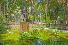 Cordoba - The monern fountain `Agricultor, Agricultura, y Progreso` Jose Carrilero 1964 in Jardines de la Agricultura. Royalty Free Stock Image