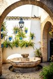 Cordoba: old typical street in the Juderia with plants and flowers. Andalucia, Spain stock photo