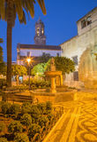 Cordoba - The Plaza de San Andres square with the little fountain at dusk. Royalty Free Stock Image