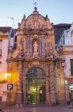 Cordoba - portale St Paul kościół przy półmrokiem od roku 1706 Zdjęcie Stock