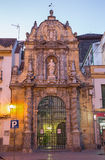 Cordoba - The portals of St. Paul church at dusk from year 1706 Stock Photo
