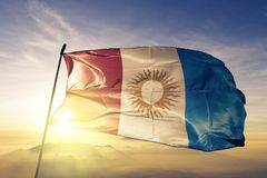 Cordoba province of Argentina flag textile cloth fabric waving on the top sunrise mist fog. Beautiful stock photography
