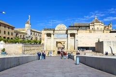 Cordoba. Puerta del Puente or Bridge Gate, a triumphal renaissance arch on popular Roman Bridge over the Guadalquivir river in Cordoba, Andalusia, Spain stock photography