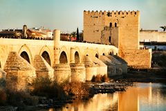 Antique roman bridge in Cordoba. Cordoba, Spain- December 30, 2018: Beautiful antique roman bridge over the Guadalquivir river at sunset in Cordoba , Spain stock image