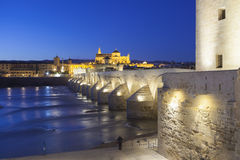 CORDOBA - SPAIN - JUNE 10, 2016 : Roman Bridge on Guadalquivir r. Iver and The Great Mosque at twilight in the city of Cordoba, Andalusia, Spain royalty free stock images