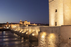 CORDOBA - SPAIN - JUNE 10, 2016 : Roman Bridge on Guadalquivir r. Iver and The Great Mosque at twilight in the city of Cordoba, Andalusia, Spain stock images