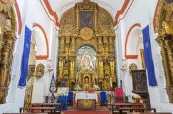 CORDOBA, SPAIN - MAY 26, 2015: The carved baroque main altar in Church Eremita de Nuestra Senora del Socorro Royalty Free Stock Photo