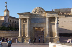 Cordoba, Spain - November 09, 2015: The gate to is located on the site of previous Roman and Moorish gates, in front the Stock Photography