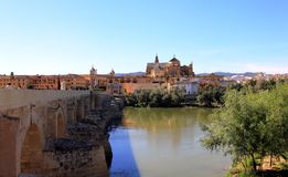 Roman Bridge on Guadalquivir river and The Great Mosque in Cordoba stock photos