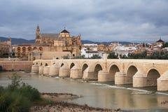 Cordoba, Spain. View at ancient Cathedral and bridge across Guadalquivir river in Cordoba, Spain stock images