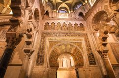 Ceiling with patterns and columns of the moorish Mezquita, Mosque-Cathedral royalty free stock photo
