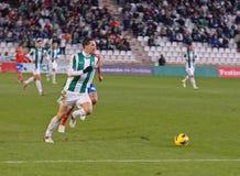 CORDOBA SPANIEN - JANUARI 13: Vincenzo Rennella W (12) i handling under matchligan Cordoba (W) vs Numancia (R) (1-0) på det kommun Arkivfoton