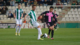 CORDOBA SPANIEN - MARS 30: Alberto Aguilar W (20) i handling under matchligan Cordoba (W) vs Sabadell (B) (3-0) arkivfoton