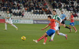 CORDOBA, SPANJE - JANUARI 13: Juanma Marrero R (16) in actie tijdens gelijkeliga Cordoba (W) versus Numancia (r) (1-0) Stock Fotografie
