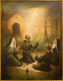 Cordoba - The St. Francis of Assisi and St. Clara at prayer in front of Porziuncola in church Convento de Capuchinos Royalty Free Stock Image