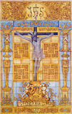 Cordoba - tiled Crucifixion by artis M. Tienda from 20. cent. on the facade of church Iglesia de San Nicolas de la Villa Stock Images