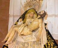 Cordoba - The traditional vested Lady of Sorrow statue (Pieta) in church Iglesia de San Augustin from 19. cent. CORDOBA, SPAIN - MAY 26, 2015: The traditional Royalty Free Stock Image