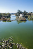 Cordoba Watermill. An old watermill on the river in Cordoba with a bridge in the distance Stock Photo