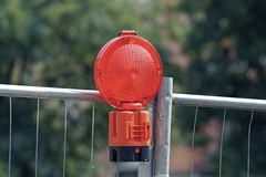 Cordon avec des voyants d'alarme à un chantier de construction Photo stock