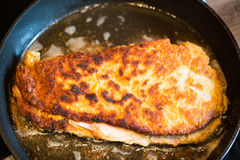 Cordon bleu in the pan on the stove Stock Images