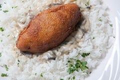 Cordon bleu with rice on a white plate Royalty Free Stock Photos