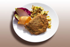 Cordon bleu roasted potatoes and vegetables served on plate Stock Photography