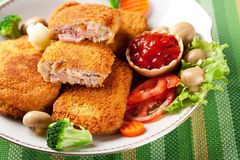 Cordon bleu with vegetables garnish Stock Photos