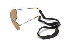 Cordon de monocle fixé aux lunettes de soleil Images stock