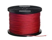 Corde rouge sur la bobine noire Photo stock