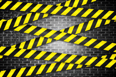 Cordon tape over grey wall Royalty Free Stock Image