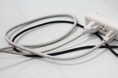 Cordones eléctricos conectados imagen de archivo libre de regalías