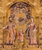 Cordova - il gruppo scultoreo scolpito della famiglia santa sull'altare principale in chiesa del monastero di St Ann e di stJosep Immagini Stock