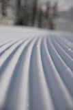 Corduroy 3. A closeup perspective of a perfectly groomed ski run Stock Photo