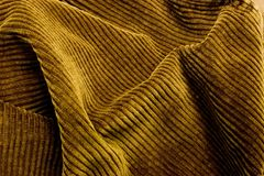 Corduroy Fabric Background Texture. Close up brown corduroy fabric background texture for clothing Stock Images