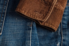 Corduroy sleeve on jeans. Royalty Free Stock Images