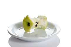 The core of apple on the saucer Stock Photo