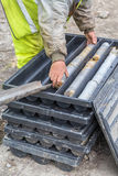 Core drill worker extracts core samples Stock Photo